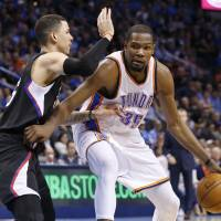 Oklahoma City's Kevin Durant drives on Los Angeles' Austin Rivers in the third quarter on Wednesday night. | AP