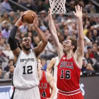 Spurs forward LaMarcus Aldridge takes a shot as Bulls center Pau Gasol defends on Thursday. | USA TODAY / REUTERS