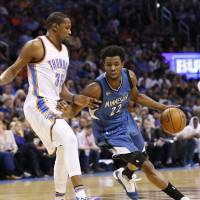 Minnesota's Andrew Wiggins drives on Oklahoma City's Kevin Durant in the first quarter on Friday night. The Timberwolves beat the Thunder 99-96. | AP