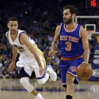 New York's Jose Calderon drives past Golden State's Stephen Curry in the first half on Wednesday night. The Warriors routed the Knicks 121-85. | AP
