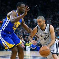Spurs guard Tony Parker tries to dribble around the Warriors' Harrison Barnes on Saturday in San Antonio. | USA TODAY / REUTERS