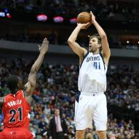 Mavericks forward Dirk Nowitzki shoots over the Trail Blazers' Noah Vonleh on Sunday in Dallas. | USA TODAY / REUTERS