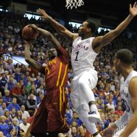 Kansas guard Wayne Selden Jr. (1) defends a shot attempt by Iowa State's Jameel McKay during their game on March 5, in Lawrence Kansas. | USA TODAY / REUTERS