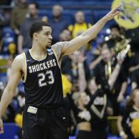 Wichita State's Fred VanVleet gestures to fans during the Shockers' win over Vanderbilt during the NCAA Tournament on Tuesday. | AP