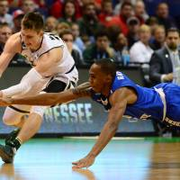 Middle Tennessee's Jaqawn Raymond (right) and Michigan State's Matt McQuaid go after a loose ball in the first half of their NCAA Tournament first-round game on Friday. Middle Tennessee State won 90-81. | USA TODAY / REUTERS