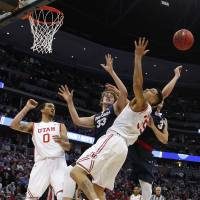 A group of players vie for a rebound during Gonzaga's victory over Utah on Saturday in Denver. | USA TODAY / REUTERS