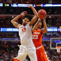 Syracuse guard Malachi Richardson (right) is fouled by Virginia's Anthony Gill on Sunday. | USA TODAY / REUTERS