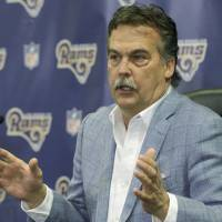 Los Angeles Rams coach Jeff Fisher speaks at a news conference in Manhattan Beach, California, on Friday. The team's players met for the first time in their new home city two months after moving from St. Louis. | AP