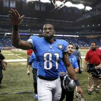 Lions receiver Calvin Johnson waves to fans as he leaves the field following a victory over the Dolphins on Nov. 9, 2014, in Detroit. | AP