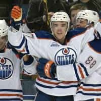 Edmonton's Connor McDavid celebrates after scoring in overtime against the Sabres on Tuesday. The Oilers won 2-1. | AP