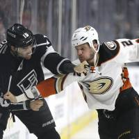 The Ducks' Kevin Bieksa (right) fights with the Kings' Andy Andreoff during the first period on Saturday. | AP