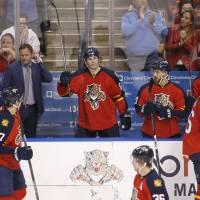 Florida's Jaromir Jagr (center) stands as the crowd cheers during the second period against Boston on Monday. Jagr passed Gordie Howe to move into third on the NHL career points list. | AP