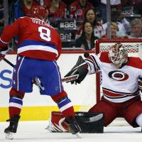The Capitals' Alex Ovechkin (left) takes a shot against Hurricanes goalie Eddie Lack on Tuesday in Washington. | AP