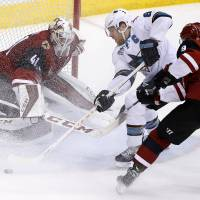 Crosby stars as Penguins rally past 'Canes