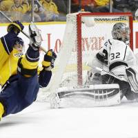 Los Angeles goalie Jonathan Quick blocks a shot by Nashville's Viktor Arvidsson (left) in the first period on Monday night. | AP