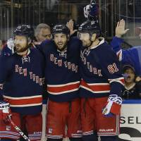 The Rangers' Derick Brassard (center) celebrates with Kevin Klein (left) and Rick Nash after scoring against the Bruins on Wednesday in New York. | AP