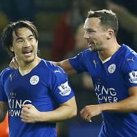Shinji Okazaki (left) has scored six goals in all competitions during his first season with the Foxes in England. | REUTERS