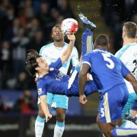 Shinji Okazaki converts an overhead kick for Leicester's only goal in a 1-0 victory over Newcastle on last week. | KYODO