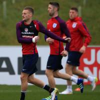 England's Jamie Vardy (left) warms up with Gary Cahill and Ross Barkley during a training session at St. George's Park in Burton, England, Tuesday . England faces Germany on Saturday in Berlin. | AP