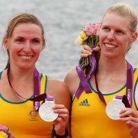 Australia's silver medalists Kate Hornsey and Sarah Tait (right) stand during the victory ceremony after the women's pair finals at Eton Dorney during the 2012 London Olympic Games. Tait has died at age 33 of cancer. | REUTERS