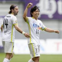 Sanfrecce Hiroshima striker Hisato Sato celebrates after scoring his 158th career J1 goal in Sunday's 1-1 draw with Nagoya Grampus. | KYODO