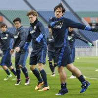 Shinji Okazaki (right) will become the first Japanese striker to reach 100 caps if he plays against Afghanistan and Syria this coming week. | KYODO