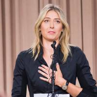 Russian tennis player Maria Sharapova speaks at a news conference in downtown Los Angeles on Monday. The former world No. 1 announced she failed a doping test at the Australian Open, saying a change in the World-Anti-Doping Agency banned list led to the violation. | AFP-JIJI