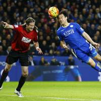 Leicester City's Shinji Okazaki heads the ball during his team's 2-2 draw with West Brom in the Premier League on Tuesday. | REUTERS