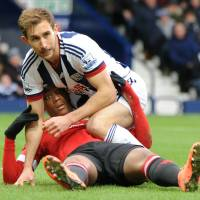 West Brom's Craig Dawson (above) gets tangled up with Manchester United's Anthony Martial on Sunday. | AP