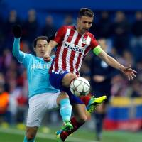 Atletico's Gabi (right) and PSV's Andres Guardado fight for the ball during their Champions League match on Tuesday. | AP