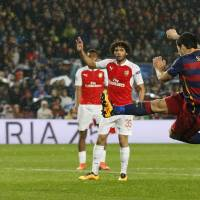 Big guns send mighty Barcelona past Arsenal, into last eight