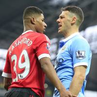 United's Marcus Rashford (left) and City's Martin Demichelis argue during their match on Sunday. | AP