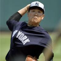Yankees starter Masahiro Tanaka tossed two innings of two-run ball against the Pittsburgh Pirates on Thursday. | KYODO