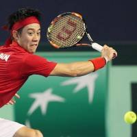 Kei Nishikori prepares to hit a shot during his match against Andy Murray in the Davis Cup on Sunday. | KYODO