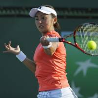 Misaki Doi hits a return to Madison Brengle in the first round of the BNP Paribas Open on Thursday in Indian Wells, California. Brengle won 6-1, 7-5. | AP