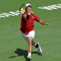 Kei Nishikori hits a shot during his match against Mikhail Kukushkin in the second round of the BNP Paribas Open on Sunday in Indian Wells, California. | AP