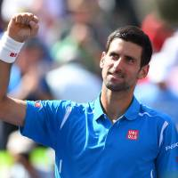 Novak Djokovic has backed off comments saying male tennis players should be paid more than their female counterparts. | AFP-JIJI