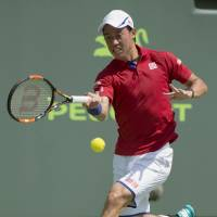 Kei Nishikori plays a shot during his 6-2, 7-6 (7-4) win over Pierre Hugues-Herbert on Saturday. | KYODO