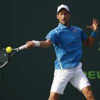 Novak Djokovic plays a shot during his third-round win over Joao Sousa at the Miami Open on Sunday. | USA TODAY / REUTERS
