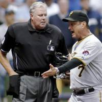Tim Welke, seen as Pittsburgh Pirates manager John Russell argues with his call at home plate on April 26, 2010, appeared in more than 4,200 games as a MLB umpire. | AP