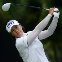 South Korea's Amy Yang hits a shot during the second round of the HSBC Women's Champions on Friday in Singapore. | AFP-JIJI