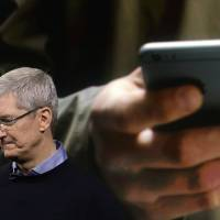 Apple logs first revenue drop since 2003 as iPhone sales slip