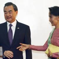 China seeks 'new chapter' in first visit with Myanmar's Suu Kyi