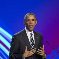 Obama in Germany plugs international trade deals, tries to counter critics
