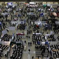 A job fair for fresh graduates takes place in Tokyo on March 20. The business sentiment of major manufacturers deteriorated to the lowest in nearly three years in the Bank of Japan's quarterly tankan survey released Friday. | REUTERS