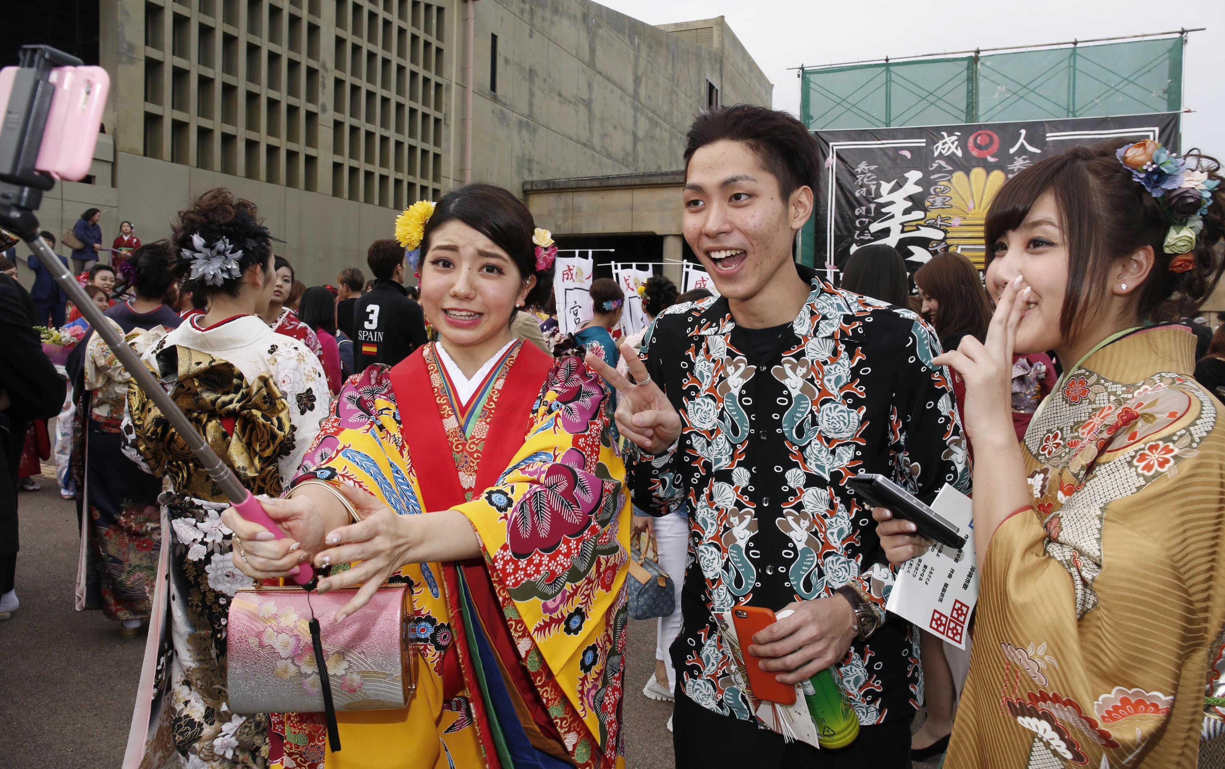Homecoming: Filmmaker Ryugo Nakamura poses for a picture at a reunion with friends back home in Okinawa.   KYODO