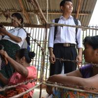 Myanmar drops charges against nearly 200 political activists: police
