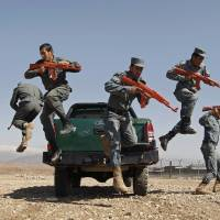 Afghan policemen take part in drills at a police training center in Nangarhar province in March 2015. | REUTERS