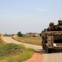 Syrian government forces' tanks patrol the town of Khan Tuman, south of the northern city of Aleppo on Monday following clashes in the area with opposition fighters the previous night. | AFP-JIJI