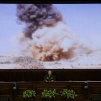 Lt. Gen. Sergei Rudskoi of the Russian military's General Staff speaks at a briefing in Moscow on Monday. The Russian military says it is helping the Syrian army fight the al-Qaida-affiliated Nusra Front around Aleppo, but has no plan to storm the city. | AP